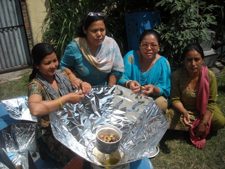 FoST Family using solar cooker.jpg
